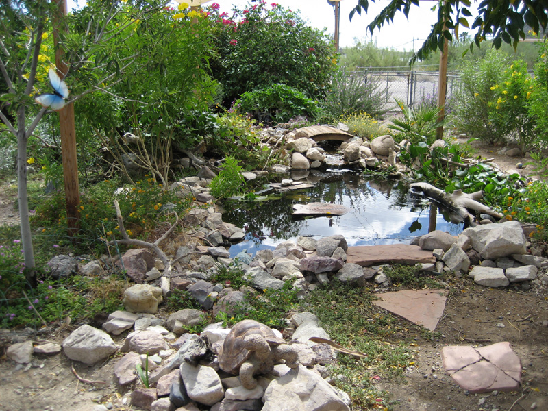 How to landscape with backyard ponds gazebos gazebo for Pond landscape